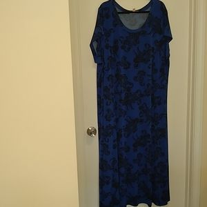 Woman within black & blue paisley print maxi dress